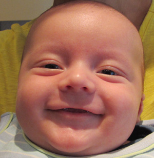 lachendes grinsendes Baby